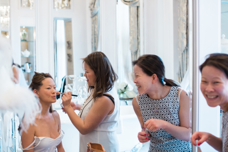 Bride preparing for her wedding in Grosvenor Hotel London with bridesmaids