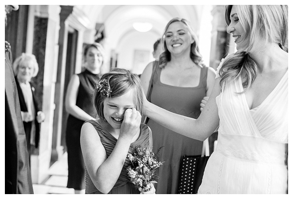 Flower girl crying after wedding ceremony in Islington