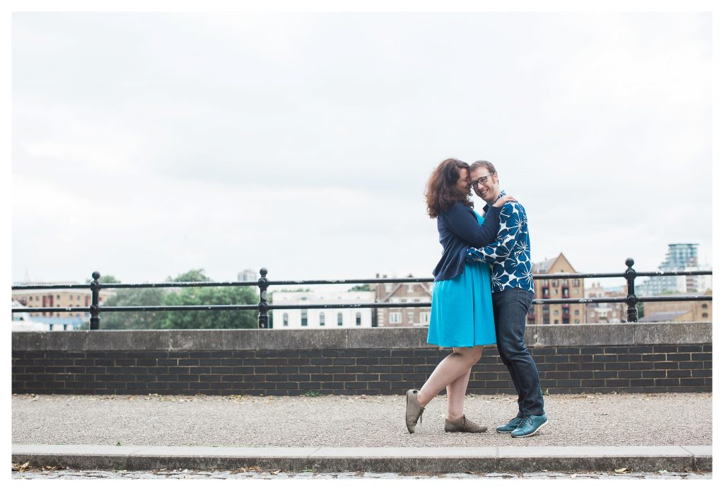 Engaged couple walking in Rotherhithe