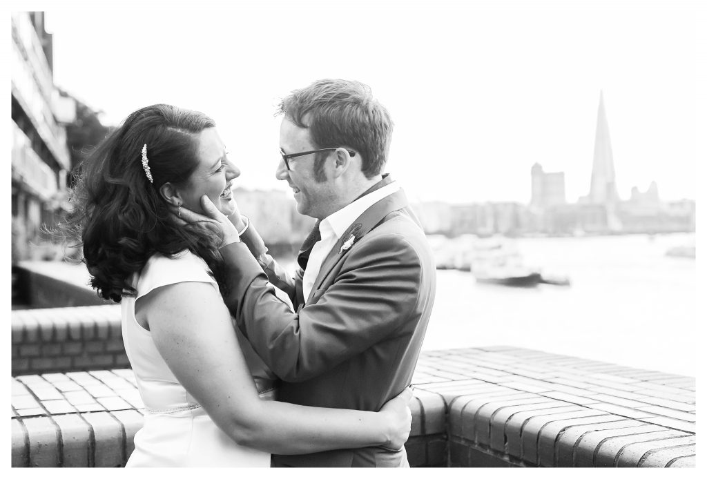 Bride and groom portraits in front of the London skyline