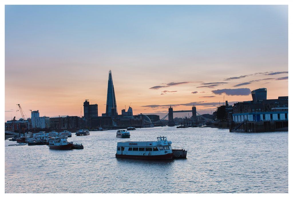 London skyline at dusk from Rotherhithe thames path