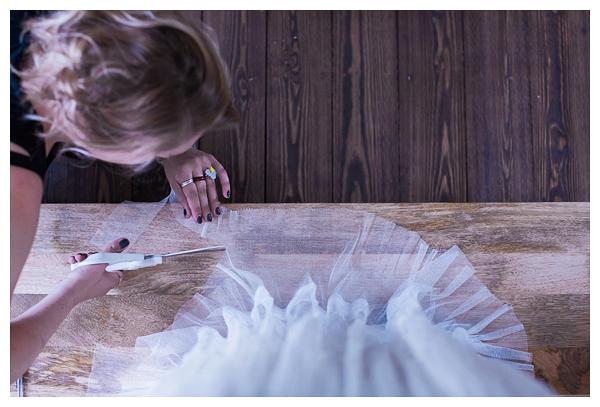 cutting bride's dress on wedding morning
