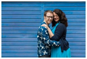 Engaged couple holding each other in Rotherhithe