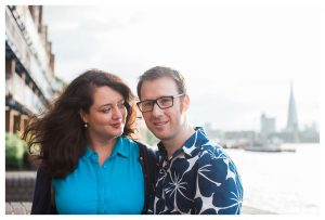 Engaged couple standing on the Thames Path in London