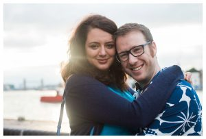 Engaged couple posing in Rotherhithe