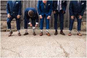Groomsmen comparing wedding socks