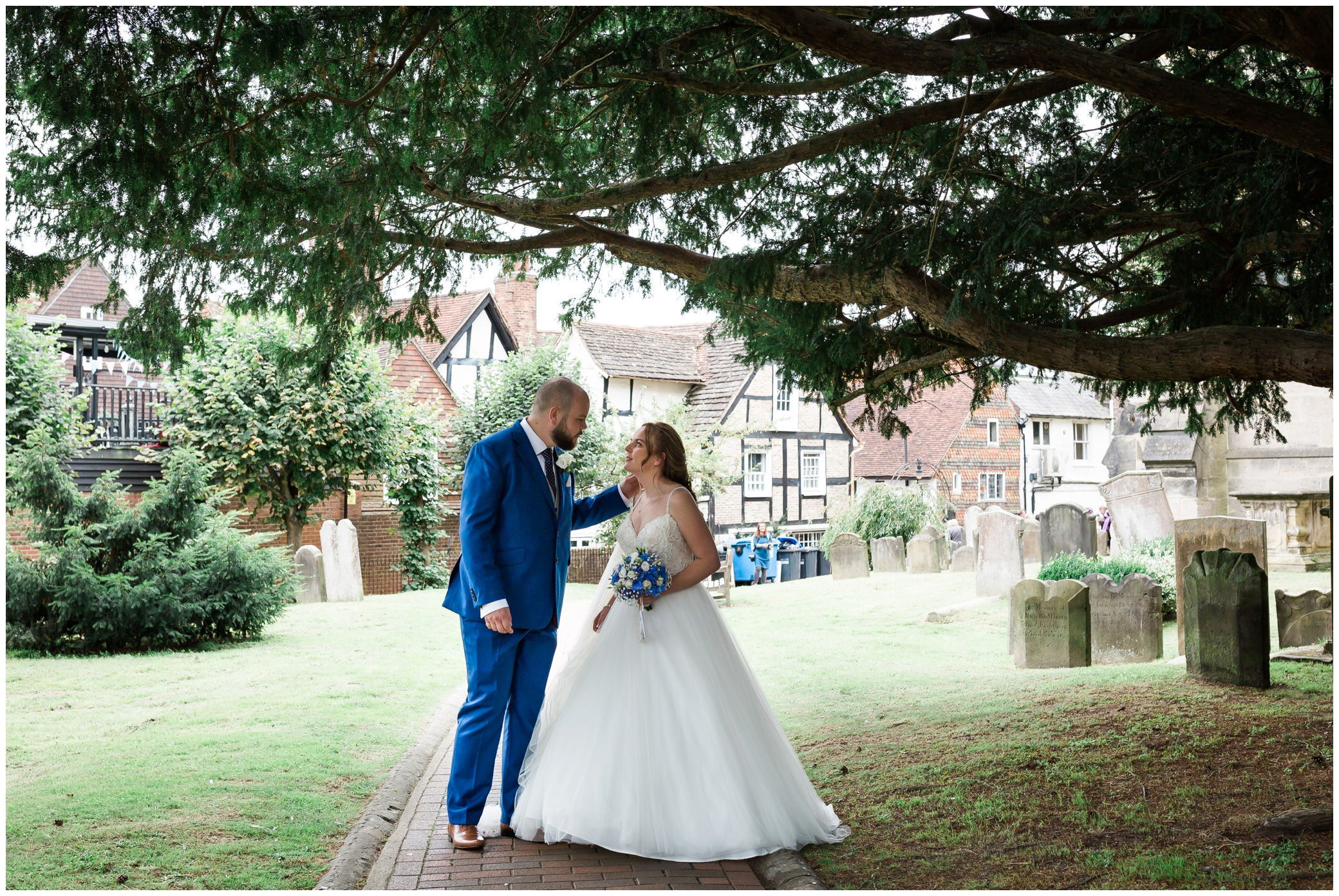 Just married couple outside St Swithun's church in East Grinstead