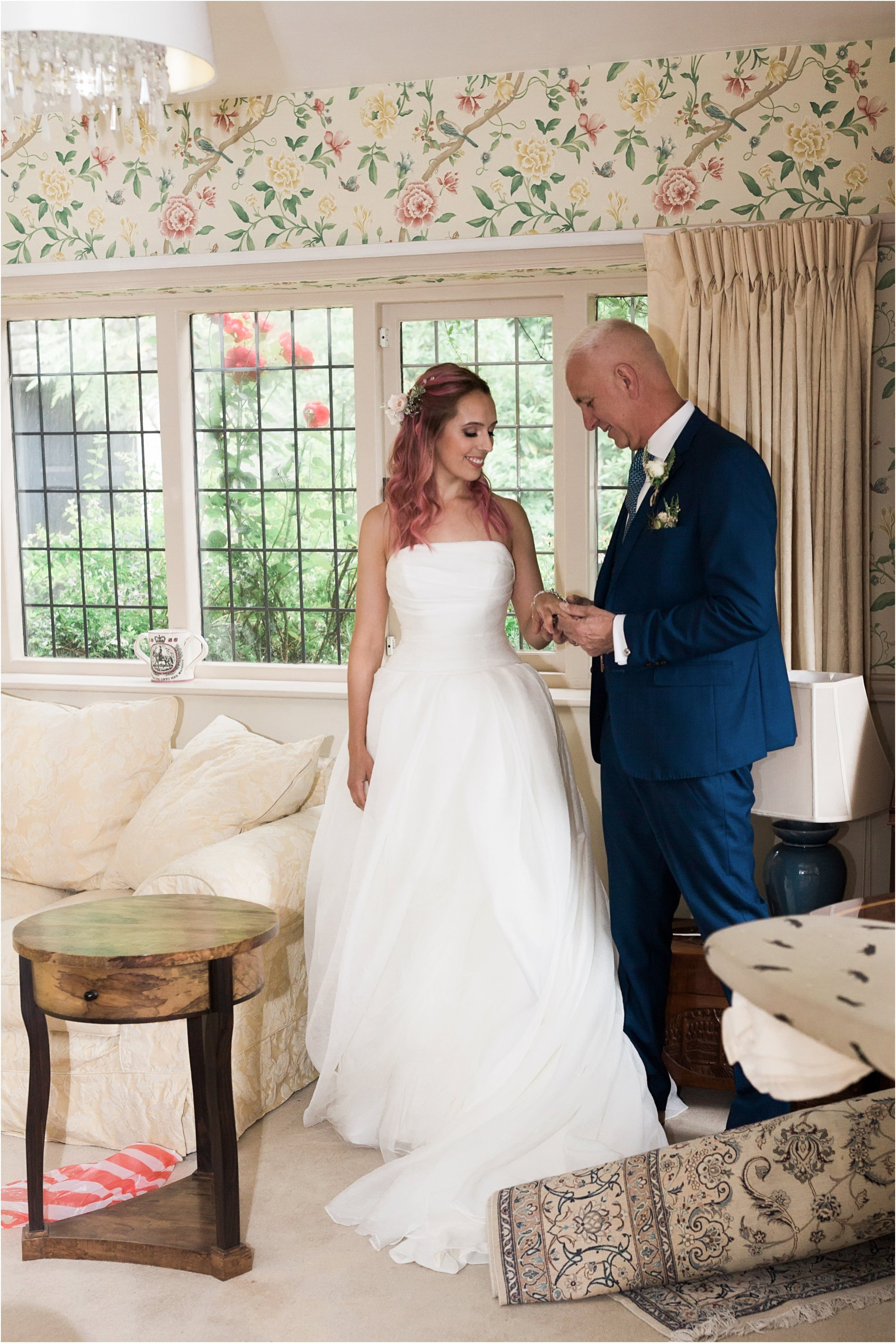 Bride with her dad on wedding morning