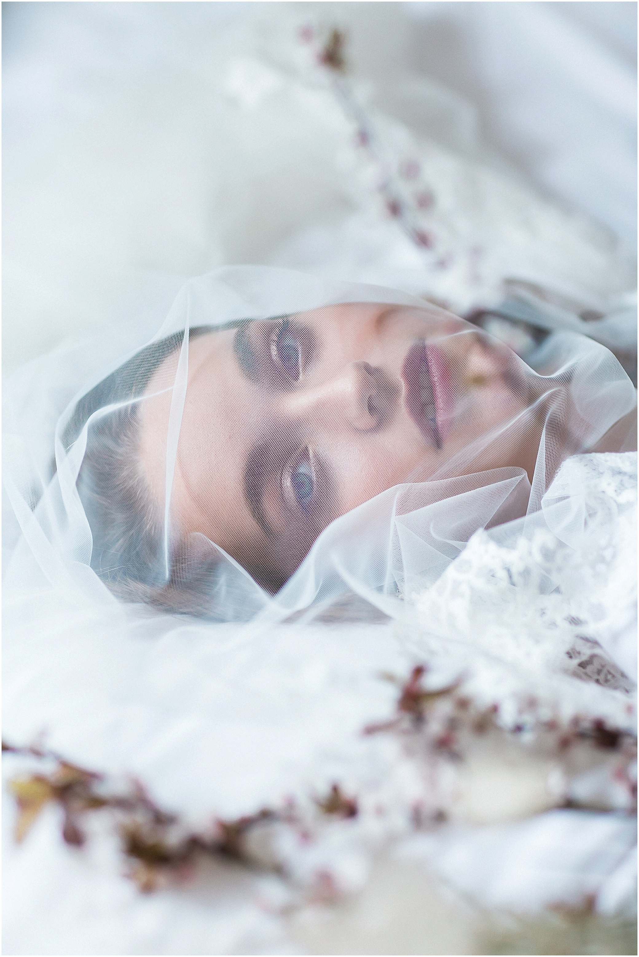 Model bride wearing veil over face