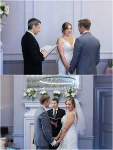 Couple exchanging vows at their wedding in the Knightsbridge room at Marylebone town hall in London