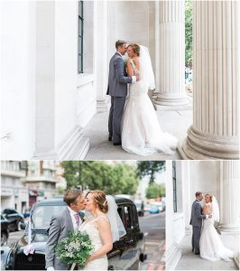 Couple posing outside Marylebone town hall in London after their wedding