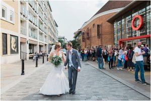 Just married couple walking to their Swan at the Globe wedding reception in London